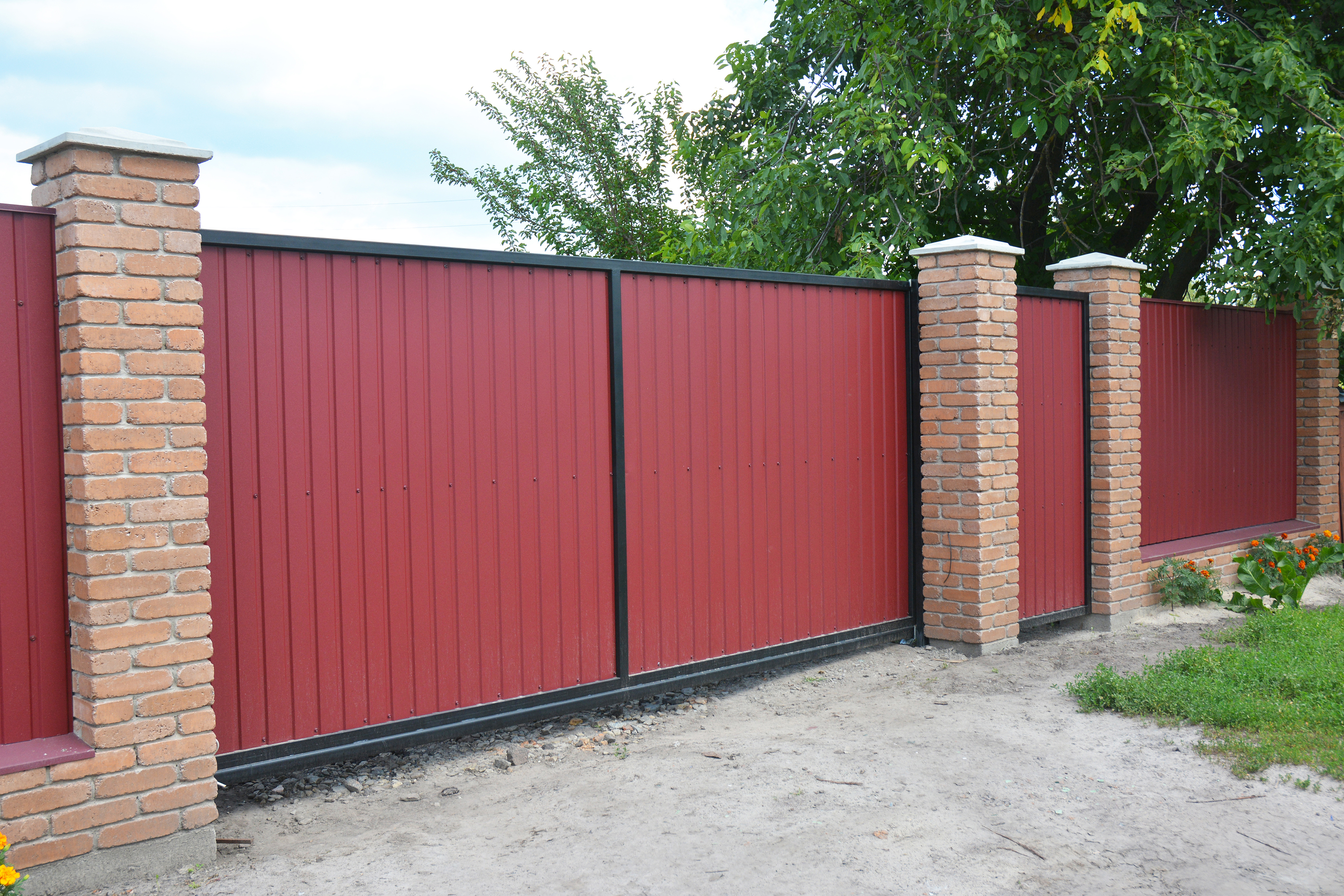 Installing Brick and Metal Fence Gate with Door. Red Metal Fencing Panels.